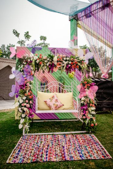 mehendi function , outfits for mehendi function , indian wedding   decor ideas for weddings , destination wedding , wedding at Fairmont, Fairmont Jaipur, Mehendi decor ideas, wedding entry