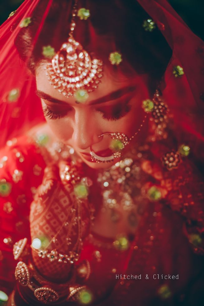 sabyasachi bride , sabyasachi lehenga , red bridal lehenga , wedding decor , indian wedding | decor ideas for weddings , destination wedding , wedding at Fairmont, Fairmont Jaipur, Mehendi decor ideas, wedding entry