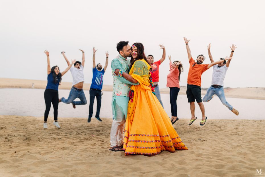 Bridal hairdo , rajasthani wedding, couple kissing , beach wedding