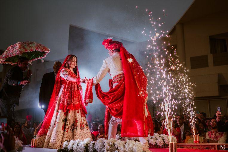 couple kissing , indian groom , Rajasthani wedding   DIY lehenga design   Bridal hairdo   footear   boss bride customised   wittyvows real wedding  