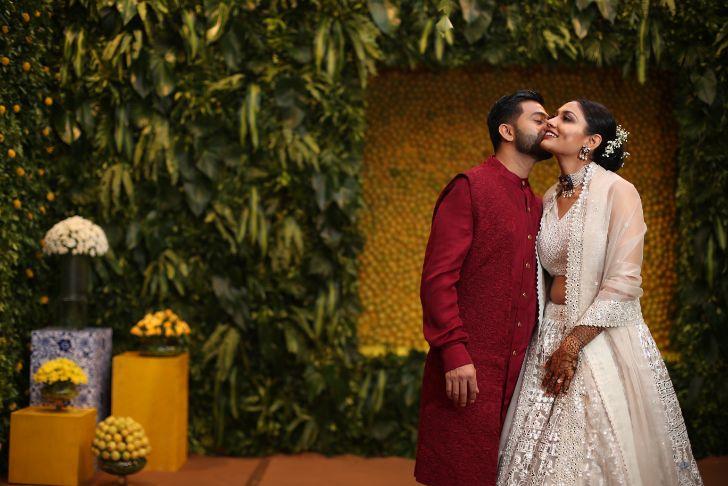indian couple kissing , couple goals , indian bride and groom , indian wedding decor ideas , decor trends , ndian couple kissing | indian wedding , wittyvows , wedding blog , Gujarati wedding wedding decor Moroccan Theme Mehendi Decor