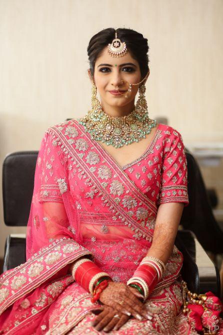 inidnan birdal portrait | red lehenga | red chooda | delhi wedding , summer wedding , mehendi look
