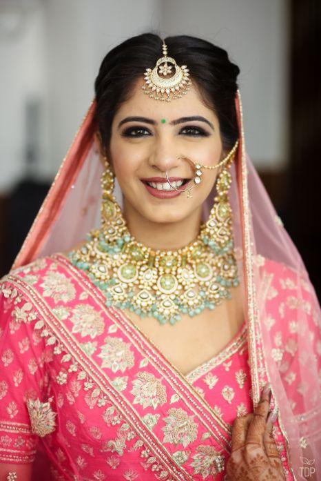 inidian couple  | delhi wedding | summer wedding | inidnan birdal portrait | red lehenga | red chooda | delhi wedding , summer wedding , mehendi look