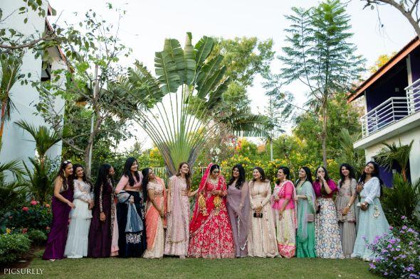 indian bridesmaid , indian groomsmen , destination wedding   wedding in Goa   beachside mandap   mehndi look