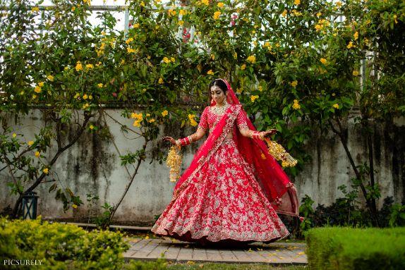 twirling , red lehenga , wittyvows , indian weddings , indian bride , red chooda , goa wedding ,