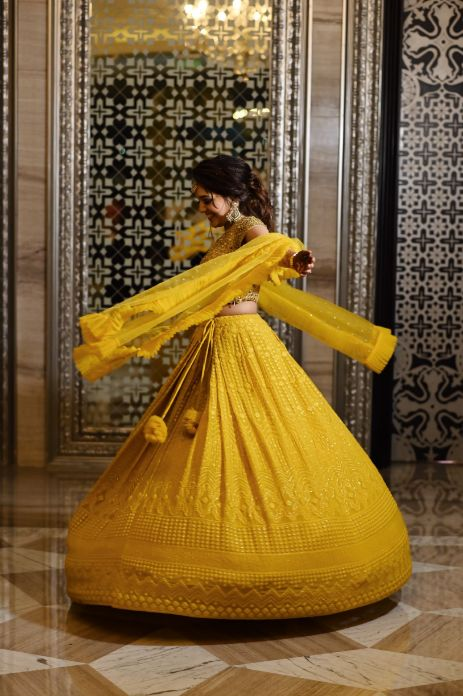 twirling moment , indian wedding , yellow lehenga , sister of the bride outfits , roka lookk, engagement outfit