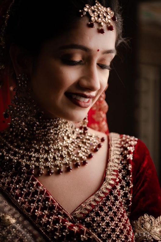 candid moments , bridal looks , wedding look , red lehenga , bridal mehendi , floral hands , floral jewellery , intimate wedding, personalised wedding ideas