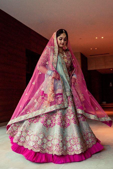 twirling bride , Pink lehenga | blouse design | cross cultural wedding | wedding in delhi