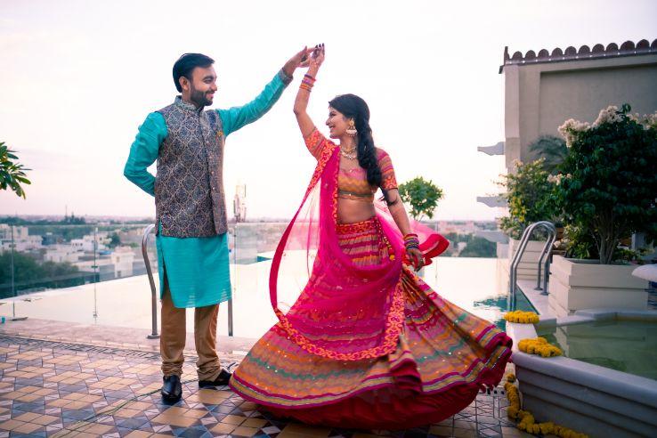 destination wedding | wedding In Rajasthan | yellow lehenga | lehenga for sangeet | mirror work | Jaimala moment