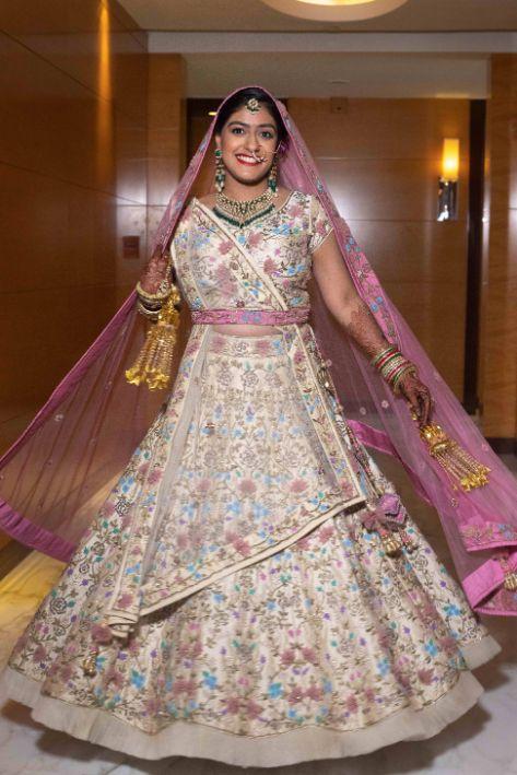bridal twirll , bridal candid photogrpahy , twirl , getting rerady , indian bride in bathtub , indian bridal lehenga , indian wedding cake , pastel wedding, grand wedding cake Chandelier cake, wittyvows , wedding blog , indian couple