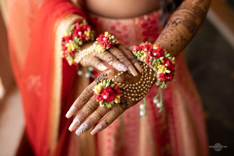 hath phool , floral jewllerey , indian bridal entry , dancing bride , Destination wedding \ wedding in Jodhpur | Colourful mehendi ideas
