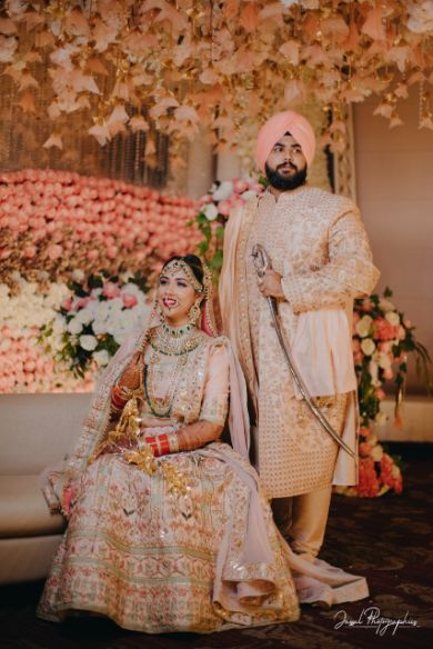 couple in matching outfits for their wedding day |