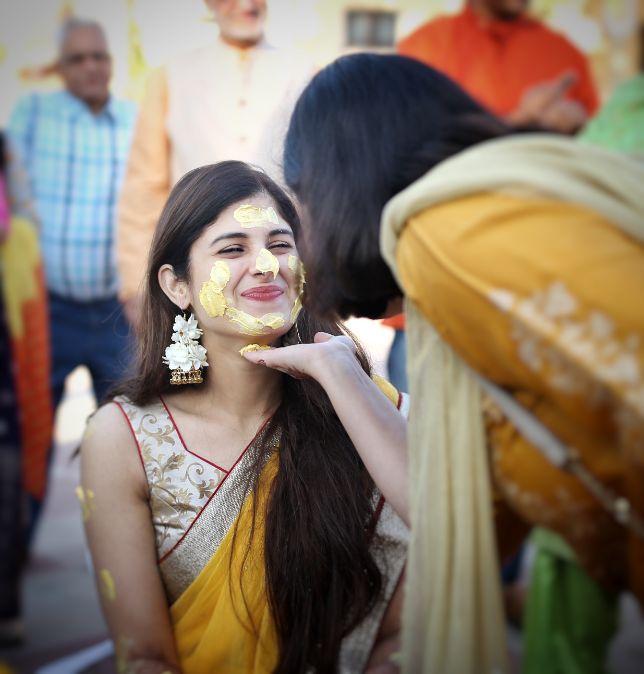 cute bride at her haldi ceremony