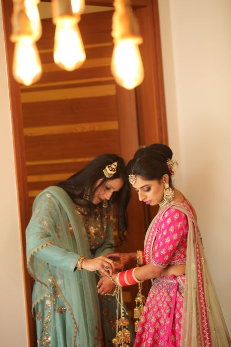 candid photos | sister of the bride | Pink Anita Dongre Lehenga