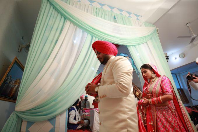 indian wedding ceremony   anand karaj ceremony   Pink Anita Dongre Lehenga