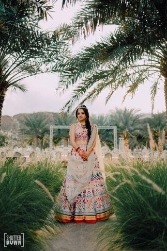 indian bride in beautiful white designer lehenga