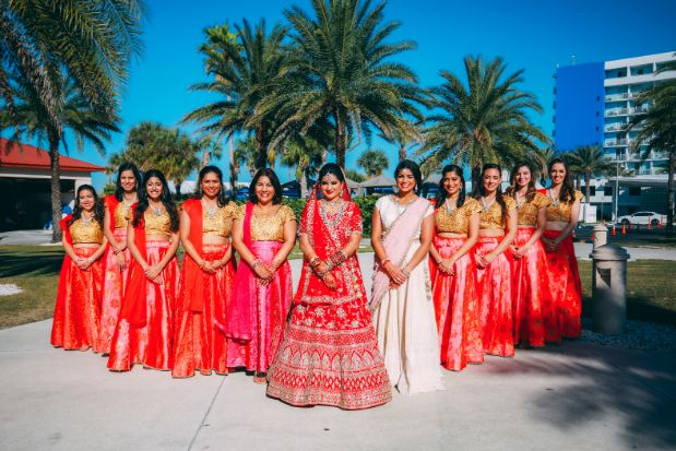 indian bridesmaid , red lehenga , indain family at weddings , NRI wedding | long-distance love story