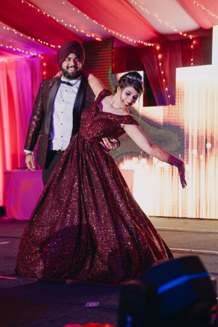 couple wearing matching outfits for their sangeet day | Sparkling Red Gown for the Cocktail