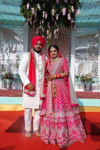 sikh couple   Pink Anita Dongre Lehenga