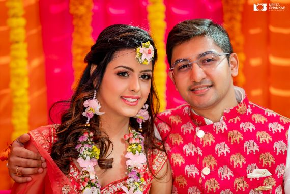 indian couple | mghendi ceremony | floral jewellery for the bride | matching outfits for the couple |