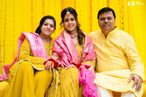 bride posing with her parents | indian wedding photography