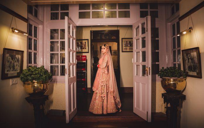 indian bride in pastel lehenga |