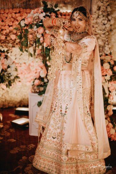 bride in beautiful pastel pink lehenga