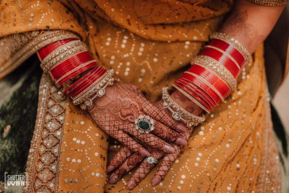 bridal mehendi hands   bridal chura   Destination wedding in Fujairah