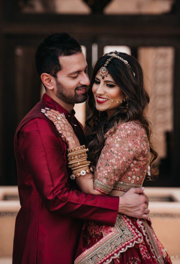 indian wedding , destination wedding in india , red lehenga , bridal details ,  Sabyasachi lehenga | wedding in Abu Dhabi|