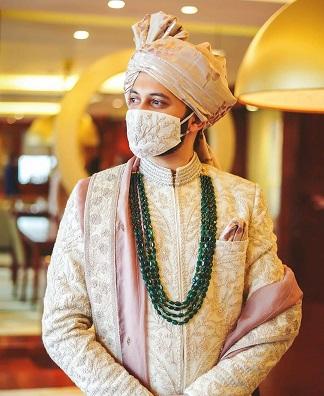 Emerald mala | Ivory outfits | Indian groom fashion