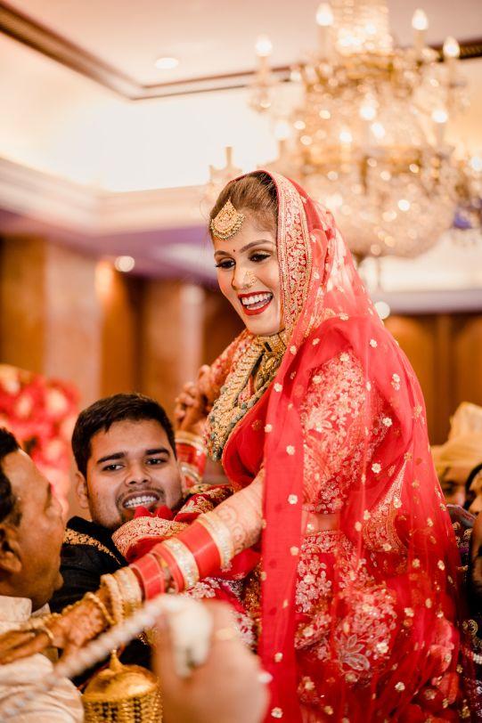 red lehenga look , indian couple , indian wedding , indian bridal lehenga , wittyvows ,   Luxury banquet wedding   yellow lehenga   floral embroidery   red wedding lehenga