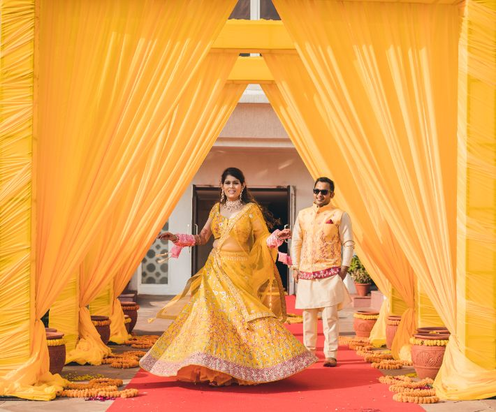 indian couple , indian wedding , indian bridal lehenga , wittyvows , | Luxury banquet wedding | yellow lehenga | floral embroidery | red wedding lehenga