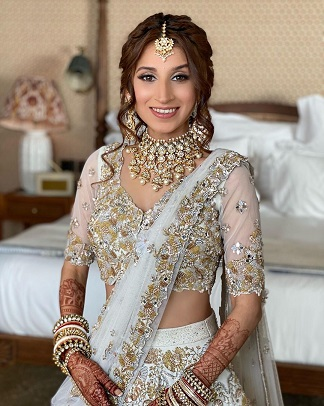 White bridal lehenga paired with traditional jewellery