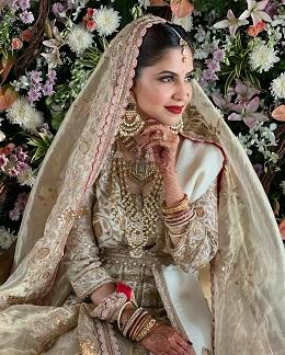 Ivory and gold sharara set by Anamika Khanna | Bridal wear