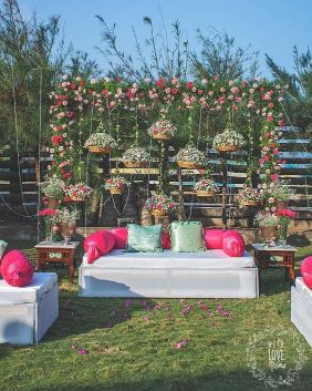 Stage with floral backdrops and sofas