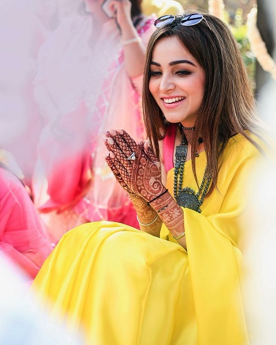 Kompal for her haldi ceremony in yellow saree and silver jewelry