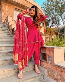 Dhoti pants styled with peplum kurti and bandhani dupatta