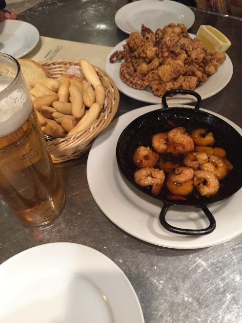 Gambas pil-pil (shrimp in garlic and oil), fried baby squid