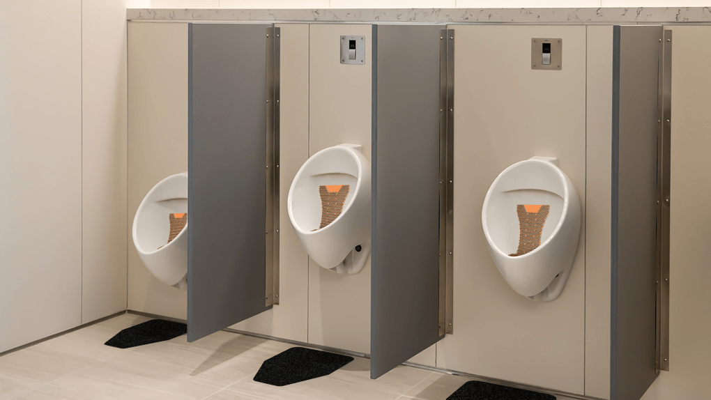 WizKid Products Mango Mini Splash Hog Vertical Urinal Screen and WizKid Original Cut Antimicrobial Mats Installed In A Public Restroom