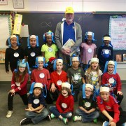 """Mrs. Coggin's second grade class dressed like """"Student 1, Student 2, etc."""" with a Kiwanis volunteer."""