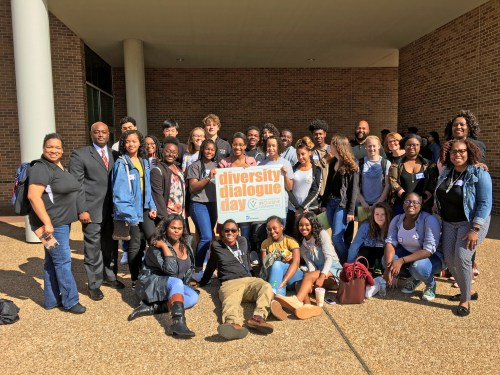 Group of students smiling outside on Diversity Dialogue Day