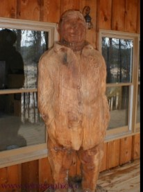Chainsaw carving of Host