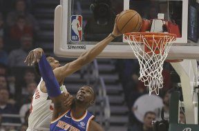 Giannis dunks over Knick AP