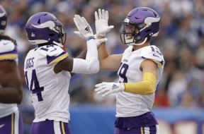 Diggs Thielen high five AP