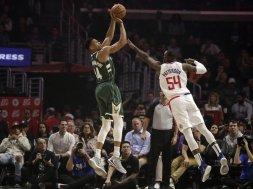 Bucks Giannis shoots Clippers Patterson AP