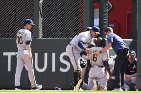 Brewers Game 3 Cain down AP