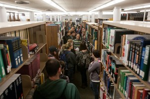 A folklore class toured the reference area of Helm Library.