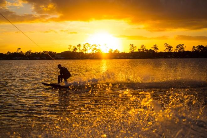 Dawson Botsford, 19, water-skis on Lake Whippoorwill on December 25, 2013.