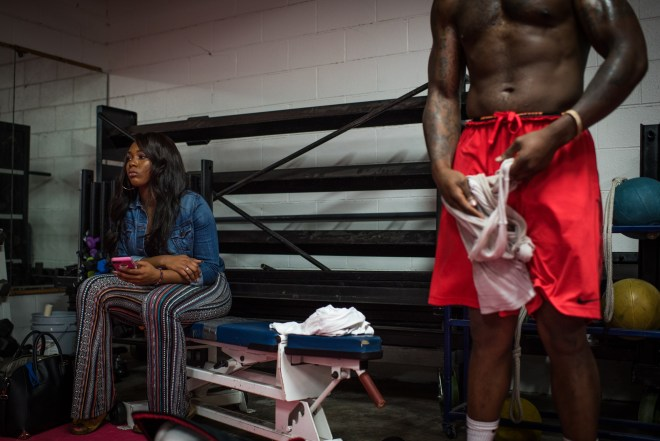 Jasmine Mayes, left, waits for her brother Rydell, right, to finish his training at the Boxing Resource Center in Nashville, Tennessee on March 30. She has witnessed his transformation and 80 pound weight loss over the last year as he has made boxing his priority and begins the transition to the professional level. The next fights throughout this year will determine his path as he attempts to drop more weight and be able to fight in the 175lb weight class.