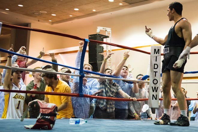 """Members of Sigma Chi yell and flip off Miguel Barzel after his fight in the 165 weight class at the Sigma Chi Battle of the fight night competition at the Salon Conference center March 18, 2016 in Bowling Green, Kentucky. """"Its fun to mess with them"""" said Barzel after the fight."""